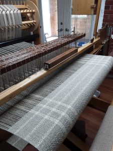 grey and cream blanket on the loom