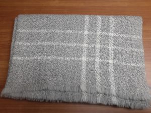 grey and cream folded blanket