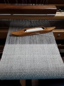 grey and cream scarf on the loom