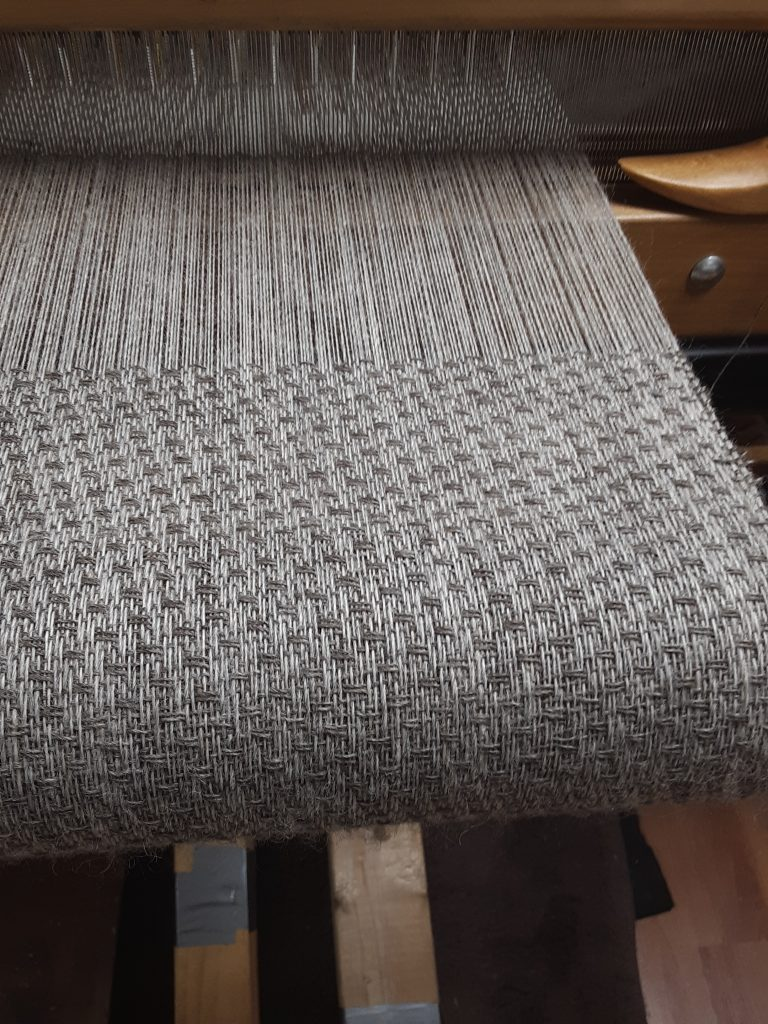dotted twill grey fabric on the loom